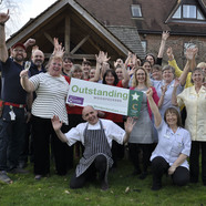 Staff members at Woodpeckers care home in Brockenhurst celebrate their Outstanding rating from the CQC.